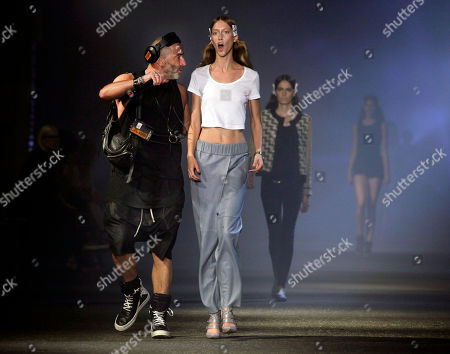 Etienne Russo Fashion show producer Etienne Russo, left, from Brussels, schools a model during rehearsal for the Prabal Gurung Spring 2013 collection, during Fashion Week in New York