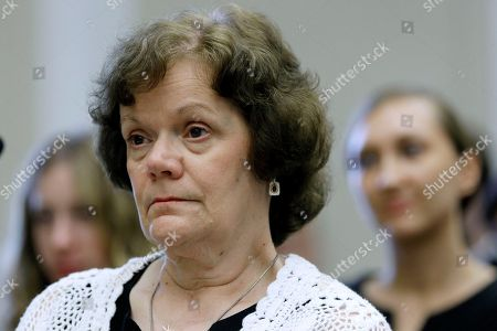 """Ann Patterson Ann Patterson, the daughter of Walter Patterson, listens to testimony during The Commission on Security and Cooperation in Europe (U.S. Helsinki Commission) hearing on """"Justice in the International Extradition System: The Case of George Wright and Beyond,"""", on Capitol Hill in Washington"""