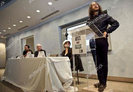 "Actor and activist Mark Ruffalo, far left, Cornell University Professor Anthony Ingrafffea, second from left, and Yoko Ono, second from right, listens as Sean Lennon speaks during a press conference to launch a coalition of artists opposing hydraulic fracturing on in New York. The formation of the group, called Artists Against Fracking, comes as New York Gov. Andrew Cuomo decides whether to allow shale gas drilling using high-volume hydraulic fracturing called hydrofracking. The group says such drilling is harmful and poses the threat of contamination. They say they want to spread awareness of the issue through ""peaceful democratic action."" Cuomo is expected to allow drilling to begin on a limited basis near the Pennsylvania border. The group is comprised of 146 members including Lady Gaga, Paul McCartney and Alec Baldwin"