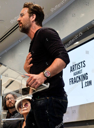 Sean Lennon, left, and Yoko Ono, center, listens as actor and activist Mark Ruffalo speaks during a press conference to launch a coalition of artists opposing hydraulic fracturing on in New York. Ono and her Lennon have joined the coalition called Artist Against Fracking to lobby Gov. Andrew Cuomo to ban the practice of drilling for gas in New York
