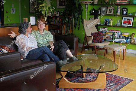 HILL Carol Anastosio,left, and Mimi Brown speak in their New York home. They are celebrating their one-year anniversary after New York State legalized gay marriage last year