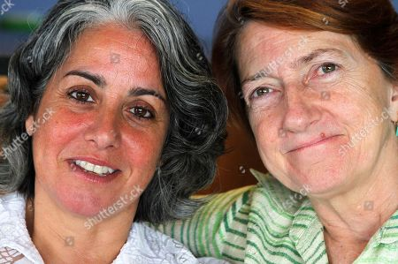 HILL Carol Anastosio,left, and Mimi Brown pose in their New York home. They are celebrating their one-year anniversary after New York State legalized gay marriage last year