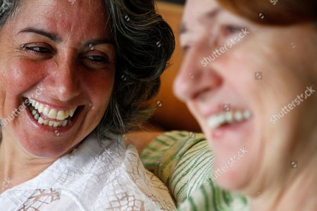 Stock Image of HILL Carol Anastosio, left, and Mimi Brown laughing in their New York home. They are celebrating their one-year anniversary. They married on July 24th 2011 after New York State passed gay marriage on July 24,2011