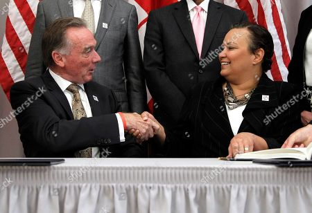 Lisa P. Jackson, Peter Kent Canada's Minister of the Environment Peter Kent, left, and EPA Administrator Lisa Jackson shake hands after signing an updated Great Lakes Water Quality Agreement, at the Canadian Embassy in Washington