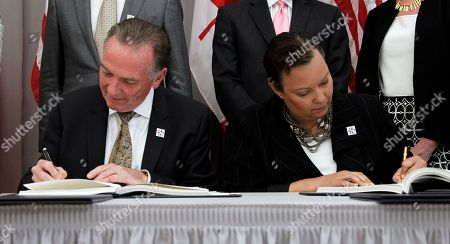 Lisa P. Jackson, Peter Kent Canada's Minister of the Environment Peter Kent, left, and EPA Administrator Lisa Jackson sign copies of an updated Great Lakes Water Quality Agreement, at the Canadian Embassy Friday in Washington