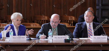 Frank M. Hull, David Wise, John Smith U.S. Circuit Judge Frank M. Hull, left, gestures as she answers a question as David Wise, of the U.S. Government Accountability Office, center, and John Smith, of the General Services Administration, right, listen during a hearing at the David W. Dyer courthouse in Miami, . Rep. John Mica R-Fla., questioned General Services Administration (GSA) and U.S. Government Accountability Office (GAO) officials during an ongoing investigation to stop the federal government from wasting billions of dollars of taxpayer's money by sitting on its assets and mismanaging valuable federal-owned properties