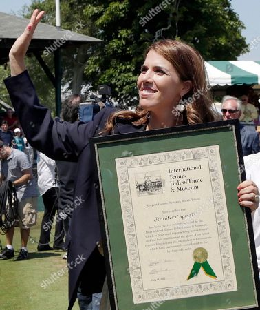 Jennifer Capriati International Tennis Hall of Fame inductee Jennifer Capriati of Tampa, Fla. waves to fans with her plaque during induction ceremonies in Newport, R.I