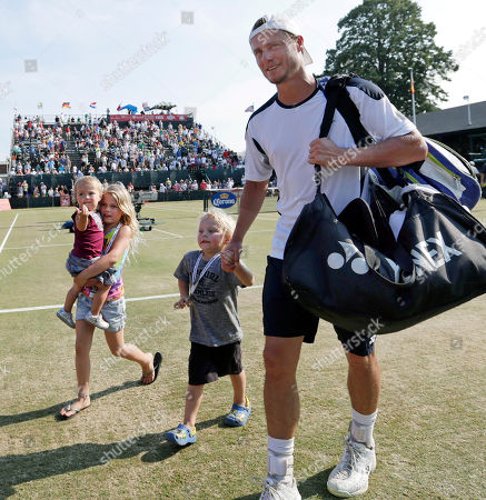 Lleyton Hewitt, Mia Hewitt, Ava Hewitt, Cruz Hewitt Lleyton Hewitt, of Australia, walks off center court with his children, daughters Mia, 6, and Ava, 20 months, and his son Cruz, 3, after a semifinal match against Rajeev Ram of the USA at the Hall of Fame tennis championships in Newport, R.I. . Hewitt won 6-4, 7-5, 6-2