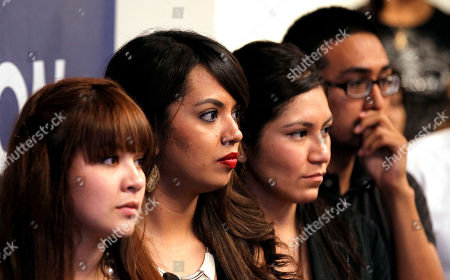 Stock Photo of Reyna Montoya, Dulce Vasquez, Diana Rios, Daniel Rodriguez From left to right, young immigrants, Reyna Montoya, Dulce Vasquez, Diana Rios, and Daniel Rodriguez line up to speak during a news conference to talk about a new federal program, called Deferred Action, that would help them avoid deportation, in Phoenix. The new nationwide program, which the U.S. Citizenship and Immigration Services began accepting those applications today, will allow young immigrants to get work permits but not a path to citizenship. The idea was to stop deporting many illegal immigrants who were brought to the U.S. as children