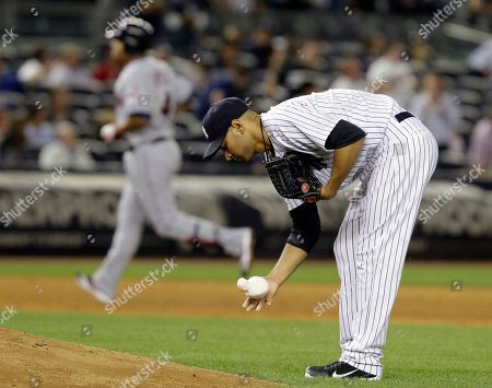 Jose Lopez, Cory Wade Cleveland Indians' Jose Lopez, left, rounds the bases after hitting a ninth-inning, three-run home run off New York Yankees relief pitcher Cory Wade, foreground, during their baseball game at Yankee Stadium in New York, . The Yankees won 6-4
