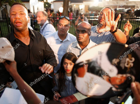 Blanket Jackson Security guards surround Blanket Jackson, bottom center, daughter of entertainer Michael Jackson, tells the crowd to get back outside Jackson's boyhood home during a celebration on what would have been Jackson's 54th birthday, in Gary, Ind