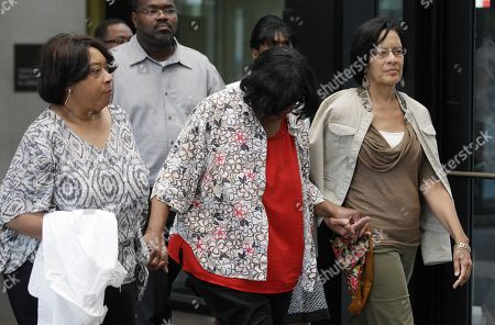Stock Photo of Supporters of Jennifer Hudson leave the criminal courts building after a Cook County judge convicted William Balfour to three life sentences plus 120 years for the murders of the mother, brother and nephew of Grammy and Oscar award winner Jennifer Hudson, in Chicago. The sentencing came after Circuit Judge Charles Burns denied a request from Balfour for a new trial. Balfour faced a mandatory life sentence. Illinois does not have the death penalty