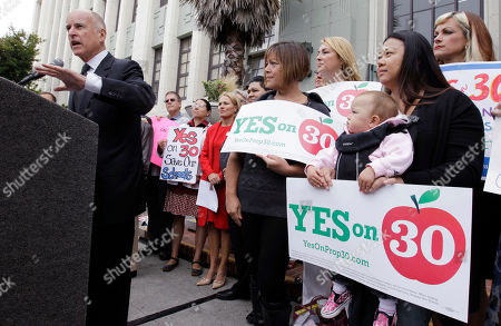 Jerry Brown, Quyen Bullard Calif. Gov. Jerry Brown campaigns supporting Proposition 30 at James Lick Middle School in San Francisco, as teacher Quyen Bullard, right, holds her daughter Madison, 14 months old. As Brown kicked off his campaign for Proposition 30 last week, he sought to emphasize that most of the revenue from the tax increases would come from Californians who are among the wealthiest; an extra $4,500 a year for millionaires, he said
