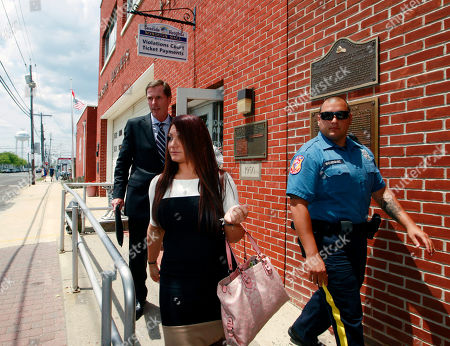 """Stock Picture of Michael Pappa, Joann Cortese Jersey Shore"""" cast member Deena Cortese, center, walks with her attorney Michael Pappa, left, from court after a hearing Tuesday, July, 3, 2012, in Seaside Heights, N.J. Cortese was in Seaside Heights municipal court on a change of interfering with traffic for an incident in which police say she was dancing in a street and blocking the flow of traffic. Cortese pleaded guilty to failing to use the sidewalk and paid a $106 fine"""
