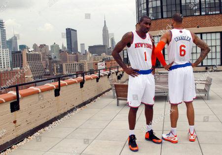 Amar'e Stoudemire, Tyson Chandler New York Knicks' Amare Stoudemire, left and Tyson Chandler pose for photographers wearing the New York Knicks new basketball uniform, in New York