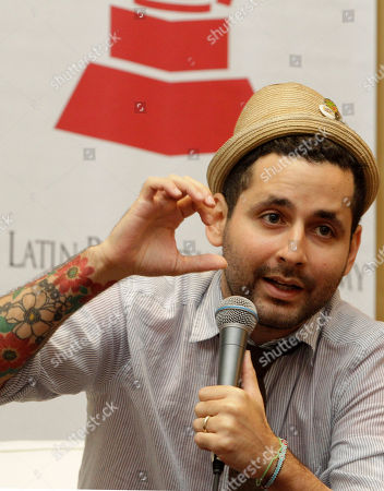 Eduardo Jose Cabra Eduardo Jose Cabra, also known as Visitante, of the Puerto Rican musical group Calle 13, gestures as he speaks during a panel discussion with the Latin Recording Academy's Gabriel Abaroa (not shown) at the Latin Alternative Music Conference in New York