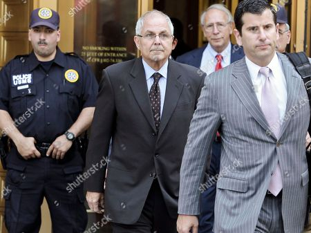 Peter Madoff, second from left, leaves Federal Court on in New York after pleading guilty to criminal charges. Peter Madoff, the younger brother and business partner of disgraced financier Bernard Madoff pleaded guilty Friday to charges he doctored documents, but insisted he knew nothing about his brother's historic Ponzi scheme. Madoff, 66, entered the plea in a deal that permits him to remain free on $5 million bail pending his Oct. 4 sentencing