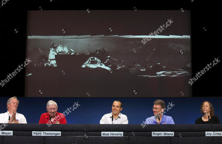 Michael Meyer, Peter Theisinger, Matt Heverly, Roger Wiens, Joy Crisp NASA scientists show a panoramic image of the Curiosity touch-down area Bradbury Landing, named after writer Ray Bradbury, showing the first tracks of the rover movements, at the Jet Propulsion Laboratory in Pasadena, Calif., . The six-wheel rover made its first test drive on Wednesday as a warm-up for the long trek to the mountain expected later this year. Shown from left: Dr. Michael Meyer, lead scientist for the Mars Exploration program at NASA Headquarters; Peter Theisinger, MSL project manger, NASA JPL, Pasadena; Matt Heverly, Lead Curiosity Driver; Roger Wiens, principal investigator of ChemCam and Joy Crisp, MSL deputy project scientist