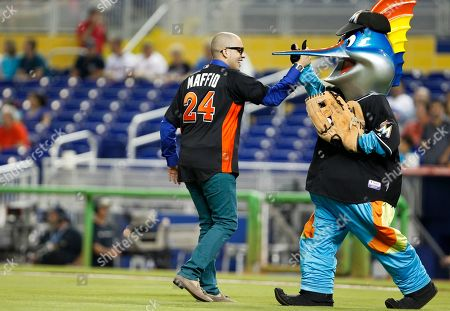 """Maffio, Billy the Marlin Dominican born producer and singer Maffio is congratulated by Miami Marlins mascot """"Billy the Marlin"""" after throwing out a ceremonial first pitch before a baseball game between the Miami Marlins and the New York Mets, in Miami"""