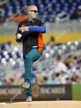 Maffio Dominican born producer and singer Maffio throws out a ceremonial first pitch before a baseball game between the Miami Marlins and the New York Mets, in Miami