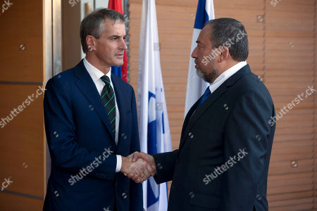 Stock Image of Avigdor Lieberman, Jonas Gahr Stoere Israeli Foreign Minister Avigdor Lieberman, right, shakes hands with his Norwegian counterpart Jonas Gahr Stoere, during their meeting in the foreign ministry in Jerusalem, . Gahr Stoere is on an official visit to the region