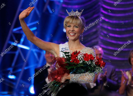 Stock Picture of Marie Wicks Miss Mississippi 2012 Marie Wicks waves as she makes her walk around the stage after being selected the winner during the televised scholarship pageant in Vicksburg, Miss