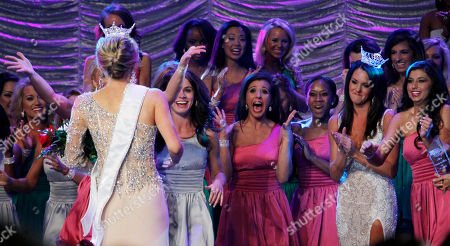 Marie Wicks The eliminated contestants react as Miss Mississippi 2012 Marie Wicks walks over to them after being crowned during the televised scholarship pageant in Vicksburg, Miss