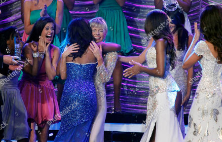 Stock Photo of Marie Wicks Miss Mississippi 2012 Marie Wicks, background, smiles as she is hugged by a contestant after being named the winner during the televised scholarship pageant in Vicksburg, Miss