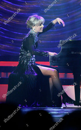 Stock Image of Marie Wicks Miss Dixie Marie Wicks plays the piano during her talent portion prior to being selected Miss Mississippi 2012 during the televised scholarship pageant in Vicksburg, Miss