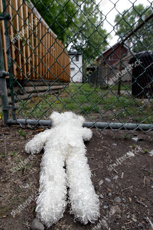 A memorial stuffed animal is shown near the back gate of a home where 5-year-old Isabella Sarah Tennant had been staying with a relative in Niagara Falls, N.Y., . Authorities said 16-year-old John Freeman and 18-year-old Tyler Best are scheduled to be arraigned Tuesday morning in Niagara Falls City Court in connection with the death of the 5-year-old New York girl. Police have charged Freeman as an adult, and he faces a murder charge. Best is charged with tampering with evidence