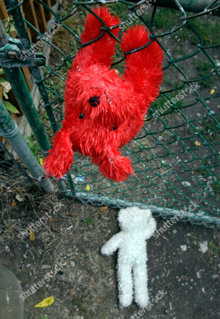 Memorial stuffed animals are shown near the back gate of a home where 5-year-old Isabella Sarah Tennant had been staying with a relative in Niagara Falls, N.Y., . Authorities said 16-year-old John Freeman and 18-year-old Tyler Best are scheduled to be arraigned Tuesday morning in Niagara Falls City Court in connection with the death of the 5-year-old New York girl. Police have charged Freeman as an adult, and he faces a murder charge. Best is charged with tampering with evidence