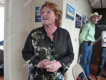 Heidi Heitkamp, left, the North Dakota Democratic candidate for the U.S. Senate, speaks during the opening of a North Dakota Democratic campaign office in Dickinson, N.D. At right is Ryan Taylor, the North Dakota Democratic candidate for governor. Heitkamp is locked in a tight race with Republican Rick Berg to succeed retiring Democratic U.S. Sen. Kent Conrad, and the race's outcome is considered crucial to GOP chances of winning Senate control