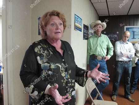 Stock Image of Heidi Heitkamp, left, the North Dakota Democratic candidate for the U.S. Senate, speaks during the opening of a North Dakota Democratic campaign office in Dickinson, N.D. At right is Ryan Taylor, with hat, the North Dakota Democratic candidate for governor, and Ryan Nagle, a Democratic campaign staffer. Heitkamp is locked in a tight race with Republican Rick Berg to succeed retiring Democratic U.S. Sen. Kent Conrad, and the race's outcome is considered crucial to GOP chances of winning Senate control
