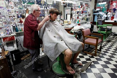 Barber Russell Hiatt, otherwise known locally as Floyd, cuts Ethan Boles' hair at Floyd's City Barber Shop in Mount Airy, N.C., . Andy Griffith, the iconic actor and North Carolina native died Tuesday at the age of 86. Hiatt cut Griffith's hair in the 50's