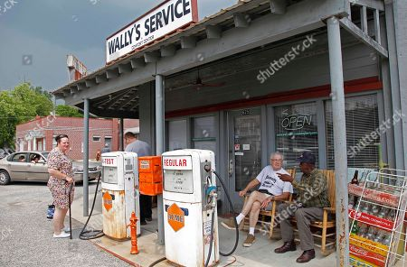 Melvin Miles and D.C. Rawley, right, chat outside Wally's Service, a replica from the Andy Griffith Show, in Mount Airy, N.C., . Griffith, the iconic actor and North Carolina native died Tuesday at the age of 86