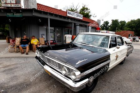 Mike and Terry Jones sit outside Wally's Service, a replica of the Andy Griffith Show, in Mount Airy, N.C., . The iconic actor and North Carolina native died Tuesday at the age of 86