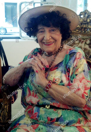 """Stock Picture of Editta Sherman In this July 9, 2012 photo, Editta Sherman poses for a photo at the """"25 CPW Gallery"""" in New York. Sherman, a photographer who in six decades of work made portraits of musicians, actors, sports stars, dancers and writers, died in her sleep on . She was 101"""