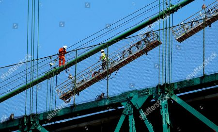 "Construction workers set up a scaffold atop the Vincent Thomas Bridge in the San Pedro section of Los Angeles on Monday Aug. 20,2012. Tony Scott, director of such Hollywood hits as ""Top Gun,"" ''Days of Thunder"" and ""Beverly Hills Cop II,"" died, after jumping from the Los Angeles County bridge, authorities said"