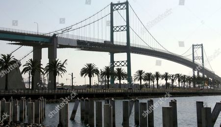 "Traffic rolls over the the Vincent Thomas Bridge in the San Pedro section of Los Angeles on . Tony Scott, director of such Hollywood hits as ""Top Gun,"" ''Days of Thunder"" and ""Beverly Hills Cop II,"" died Sunday Aug. 19, 2012, after jumping from the Los Angeles County bridge, authorities said"