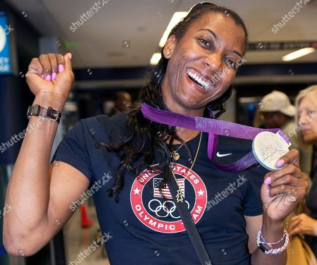 Danielle Scott Arruda U.S. Olympic indoor volleyball silver medal winner Danielle Scott-Arruda holds up her Olympic medal as she arrives at Los Angeles International airport in Los Angeles