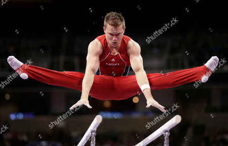Jonathan Horton competes on the parallel bars during the final round of the men's Olympic gymnastics trials, in San Jose, Calif