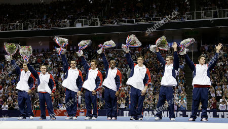 From left, Jake Dalton, Jonathan Horton, Danell Leyva, Sam Mikulak, John Orozco, Chris Brooks, Steven Legendre and Alex Naddour wave to the crowd after being introduced as members of the U.S. Olympic gymnastics team after the final round of the women's Olympic gymnastics trials, in San Jose, Calif