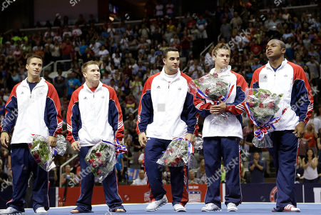 From left, Jake Dalton, Jonathan Horton, Danell Leyva, Sam Mikulak and John Orozco stand on the podium after being named as members of the U.S. men's Olympic gymnastics team after the final round of the women's Olympic gymnastics trials, in San Jose, Calif