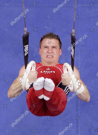 Jonathan Horton begins his routine on the rings during the final round of the men's Olympic gymnastics trials, in San Jose, Calif