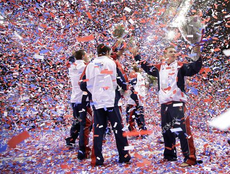 Jonathan Horton, right, celebrates with teammates after being named to the U.S. Olympic gymnastics team after the final round of the women's Olympic gymnastics trials, in San Jose, Calif