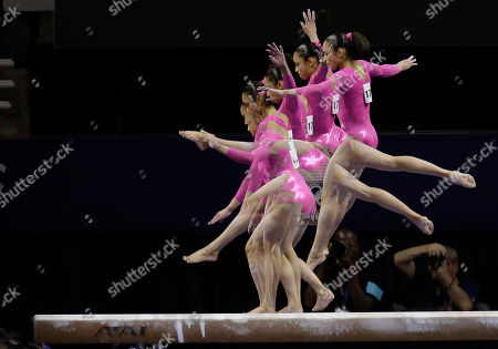 Sabrina Vega In this multiple exposure frame taken at one-fifth of a second intervals, Sabrina Vega performs on the balance beam during the preliminary round of the women's Olympic gymnastics trials, in San Jose, Calif