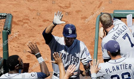 Jesus Guzman San Diego Padres' Jesus Guzman, center, is congratulated after hitting a solo home run off of San Francisco Giants pitcher Brad Penny during the eighth inning of a baseball game in San Francisco