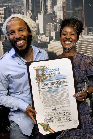 Ziggy Marley, Karen Marley Children of reggae icon Bob Marley, Ziggy Marley, left, and sister Karen Marley, pose with a copy the proclamation after the announcement by the Los Angeles City Council declaring Bob Marley Day in Los Angeles. Marley was 36 when he died of cancer in 1981