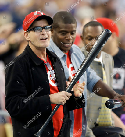 Charlie Sheen, Tony Todd Actor, Charlie Sheen, left, and friend Tony Todd show off their baseball bats during the seventh inning of a game between the Los Angeles Dodgers and the Cincinnati Reds in Los Angeles
