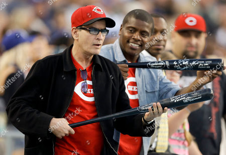 Charlie Sheen, Tony Todd Actor Charlie Sheen, left, and friend Tony Todd show off their bats during the seventh inning of a baseball game between the Los Angeles Dodgers and the Cincinnati Reds in Los Angeles